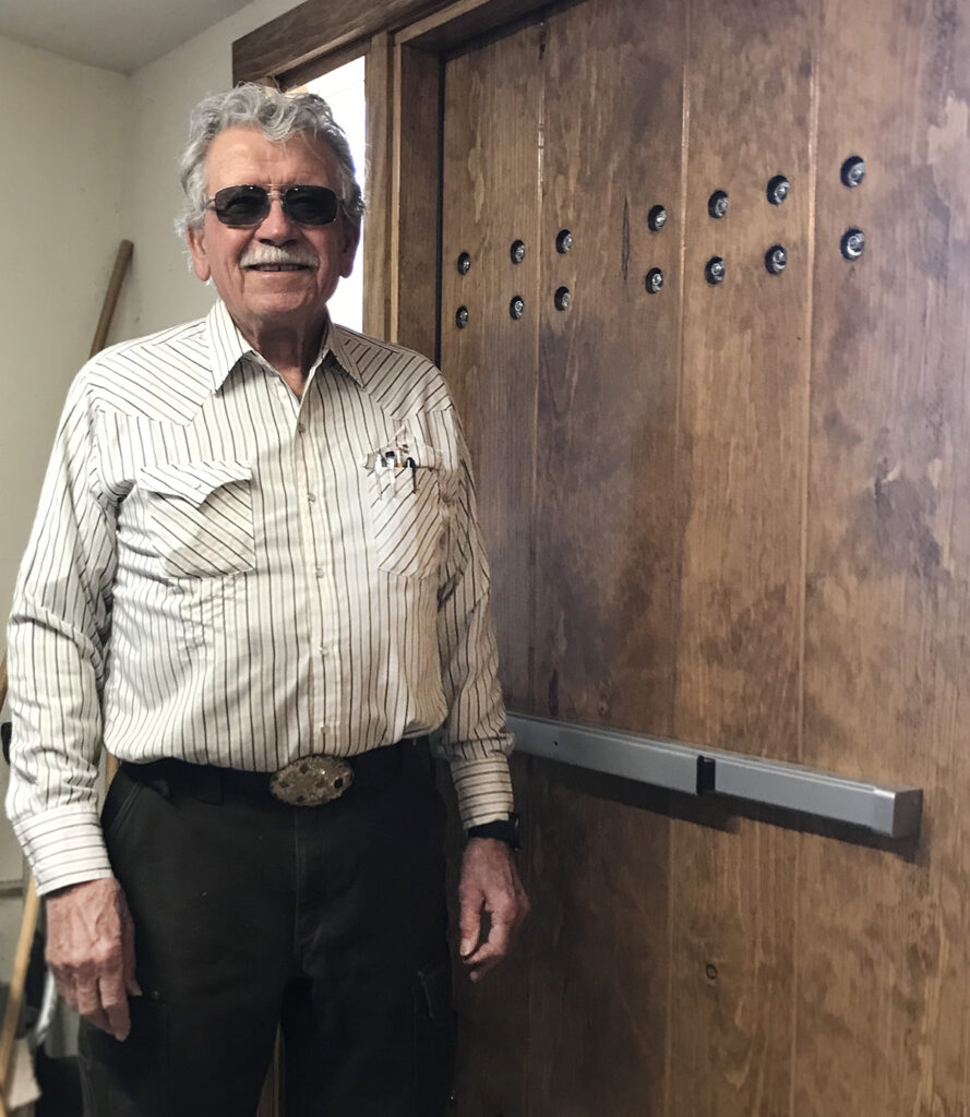 Roy Taylor with a door he built